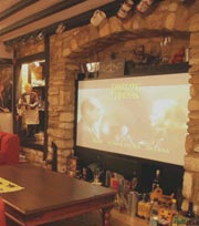 "An 84"" video screen provides the entertainment for your night in during your stay in Cricklade, Wiltshire"
